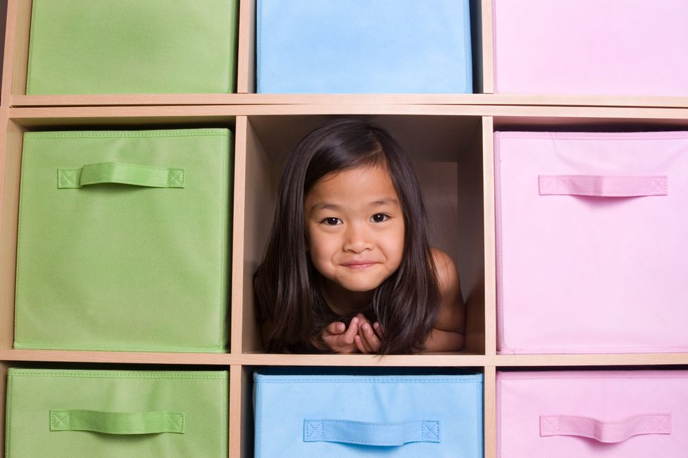 Little girl in bookcase