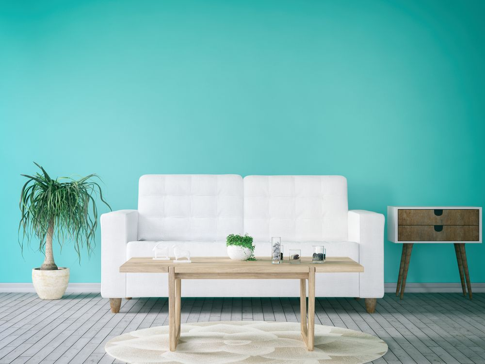Living room refreshed with a turquoise accent wall