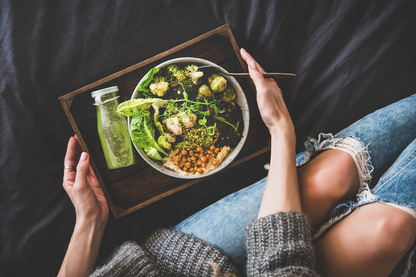 Woman with healthy bowl of green foods