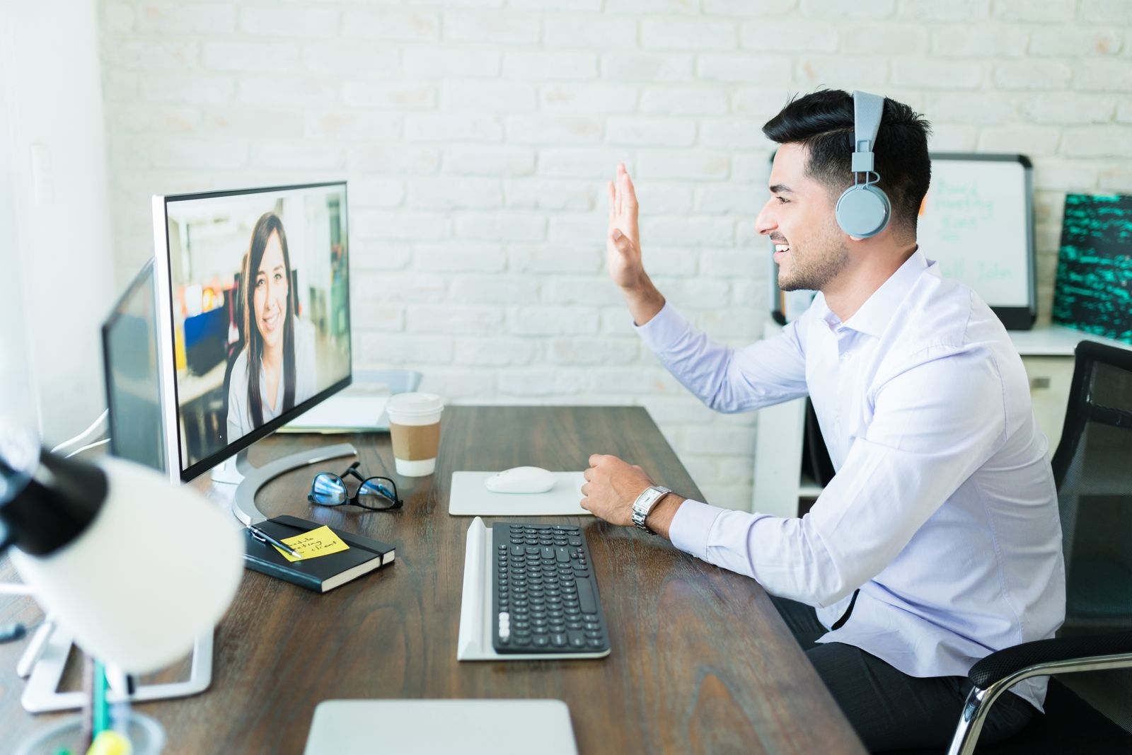 Man videoconferencing with a colleague