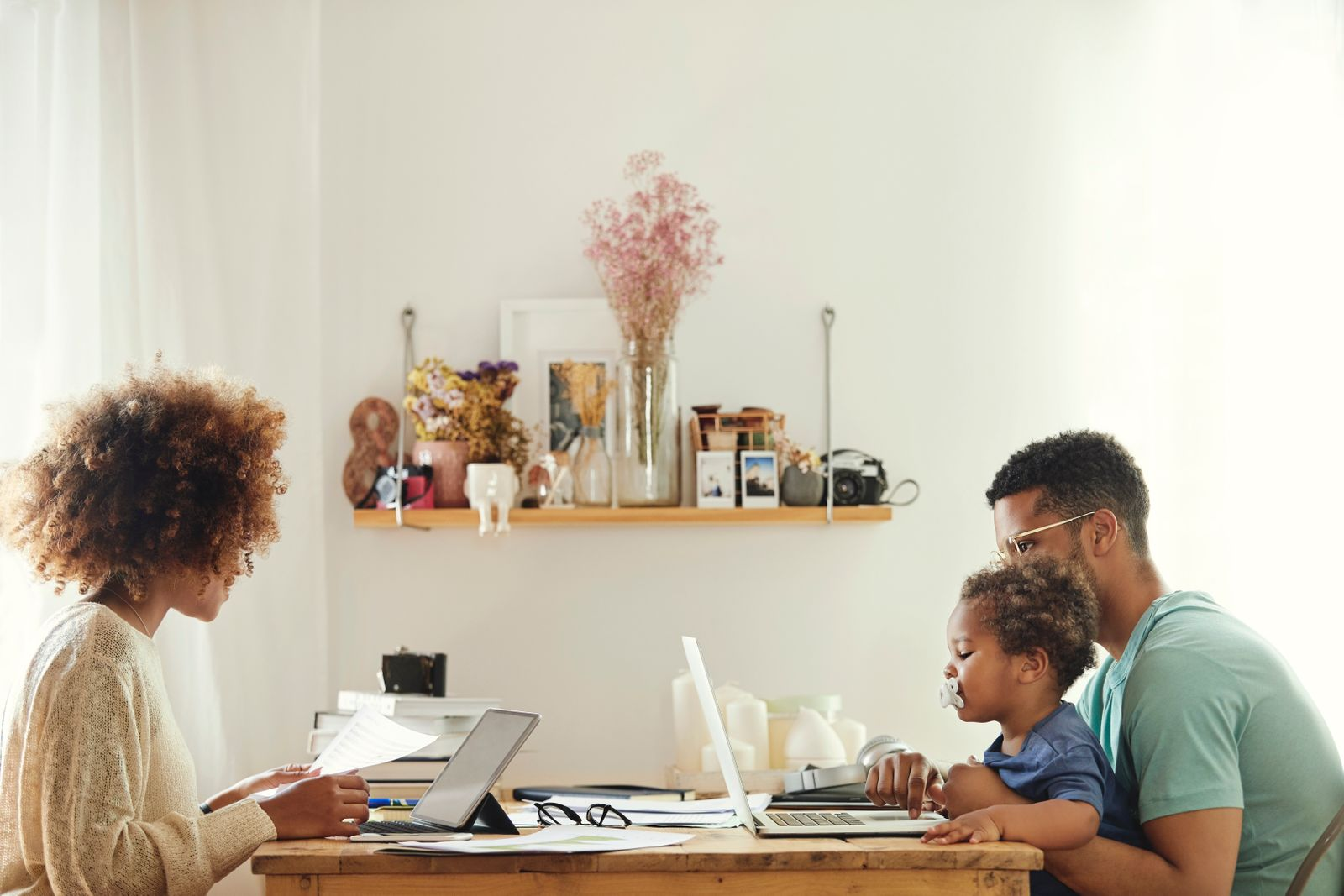 Couple working from home with their child