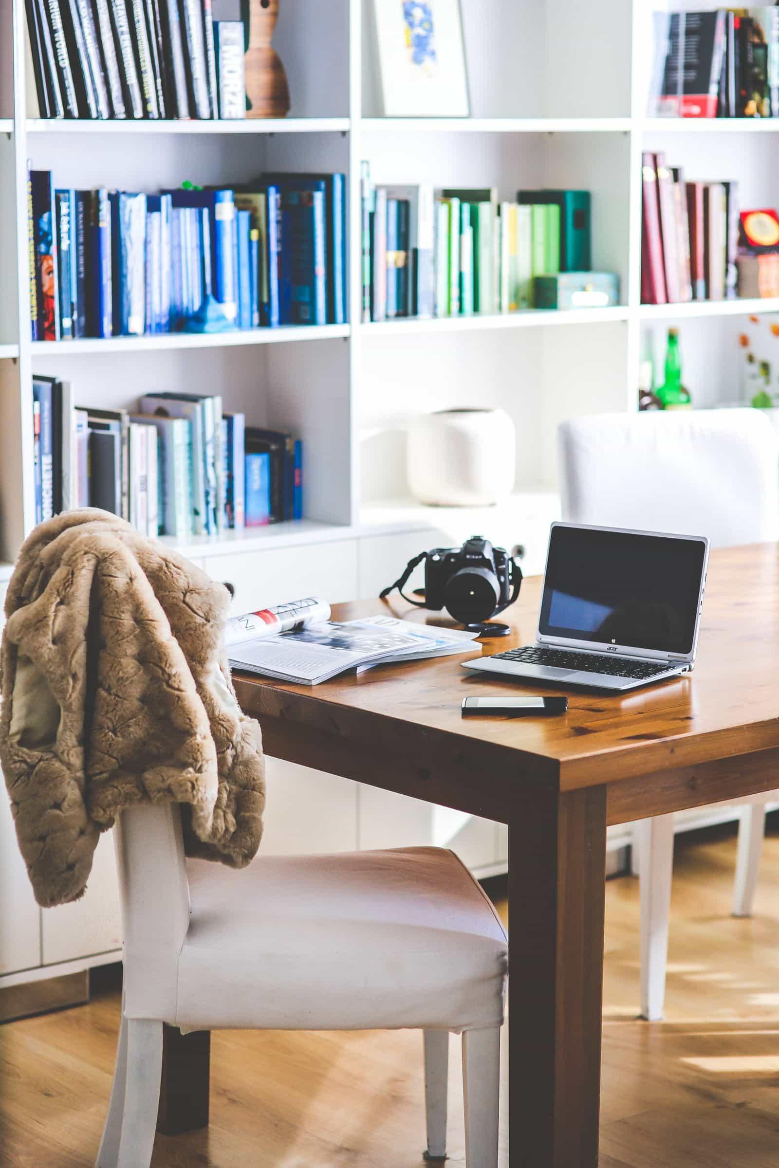 Home office with rainbow bookshelves