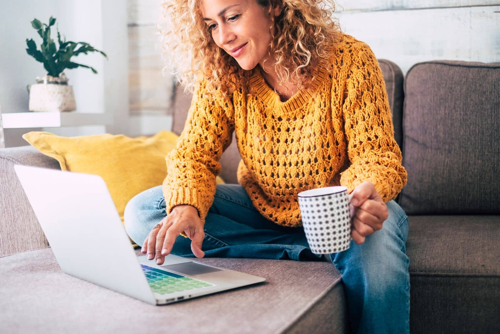 Woman working from home on her couch