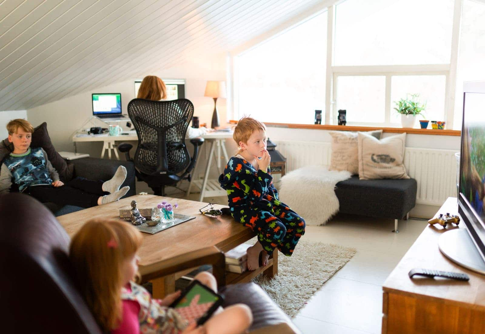 Mom working at home with children around