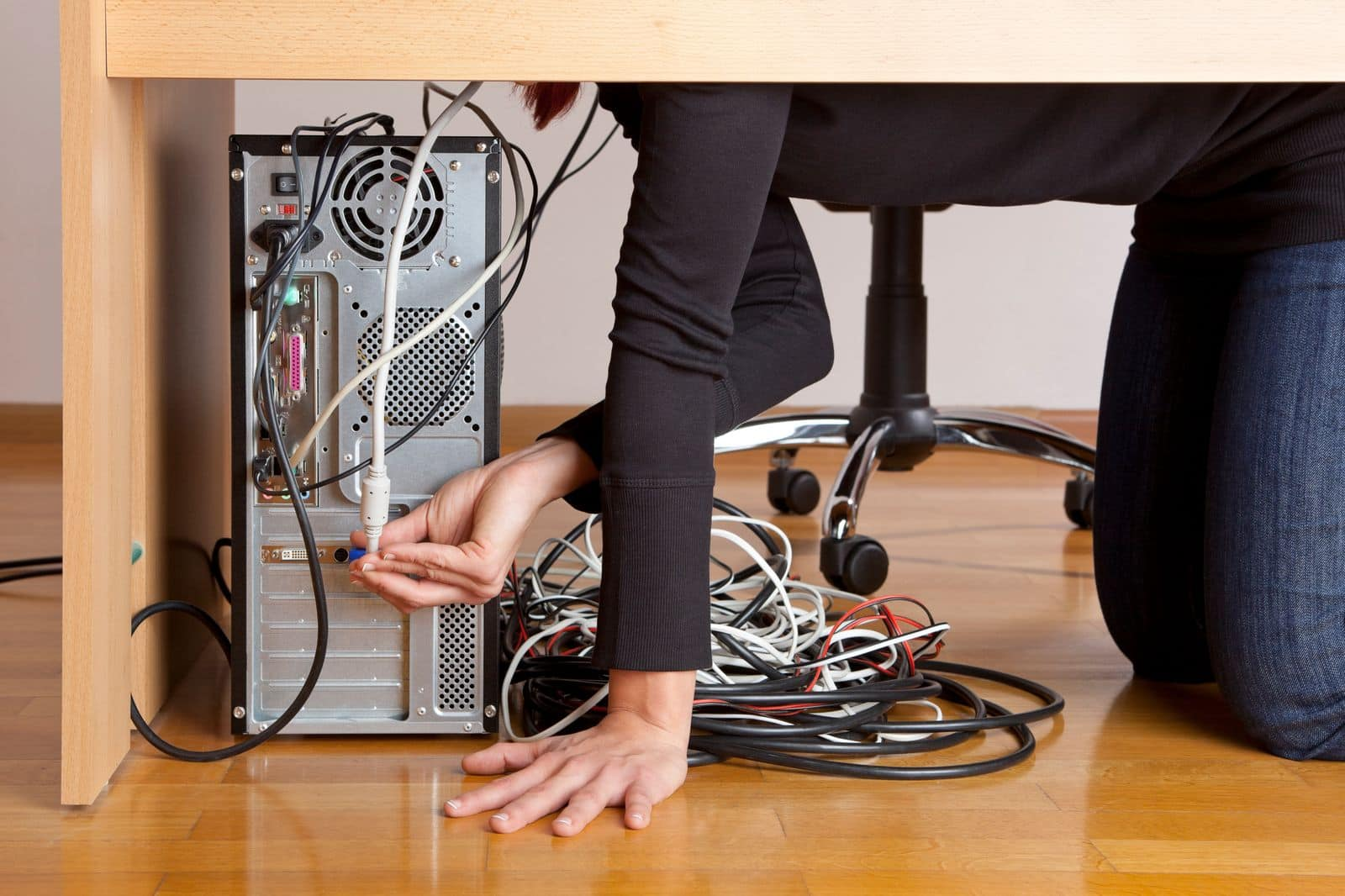 Woman sorting through knotted wires and cables