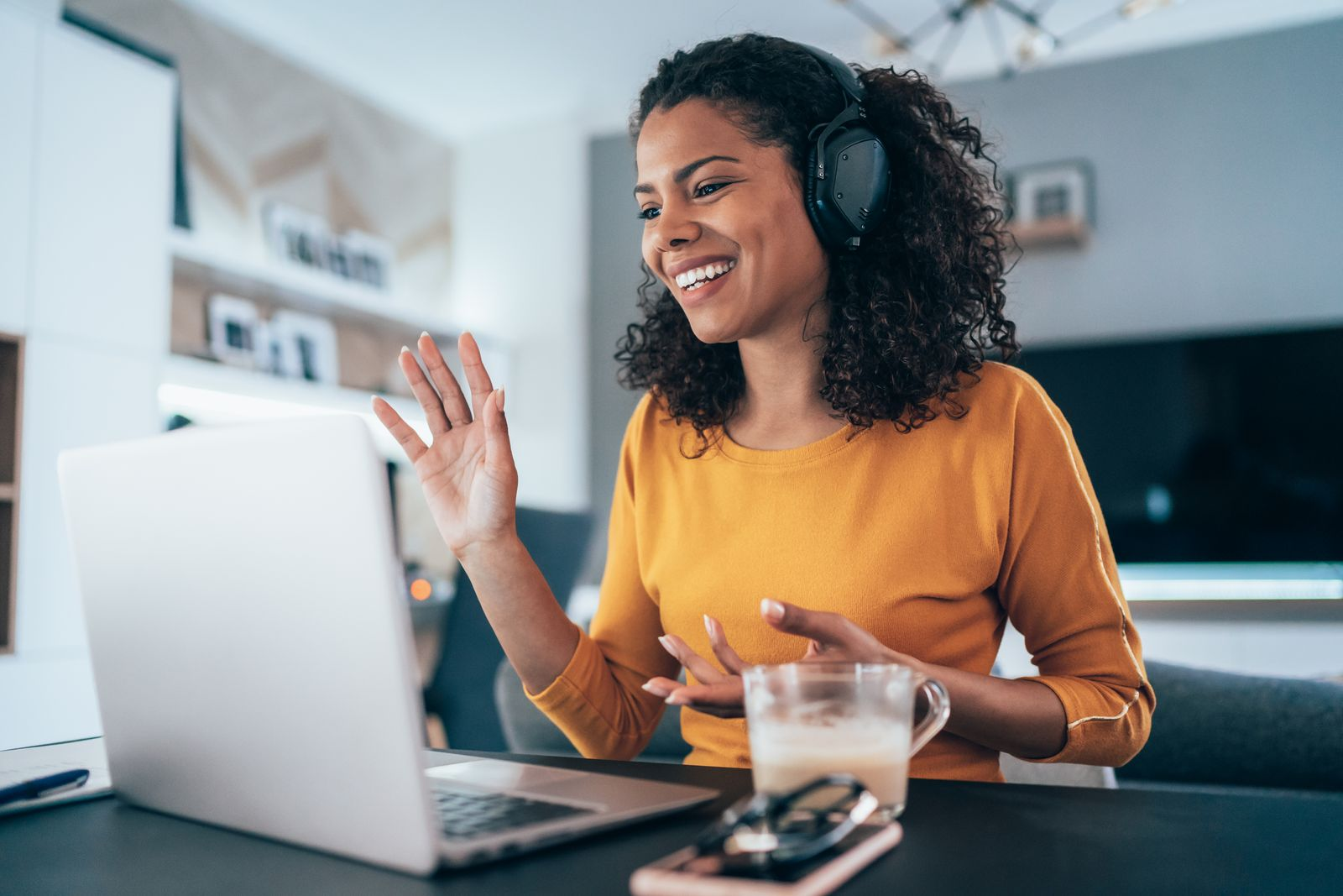 Woman videoconferencing from home office