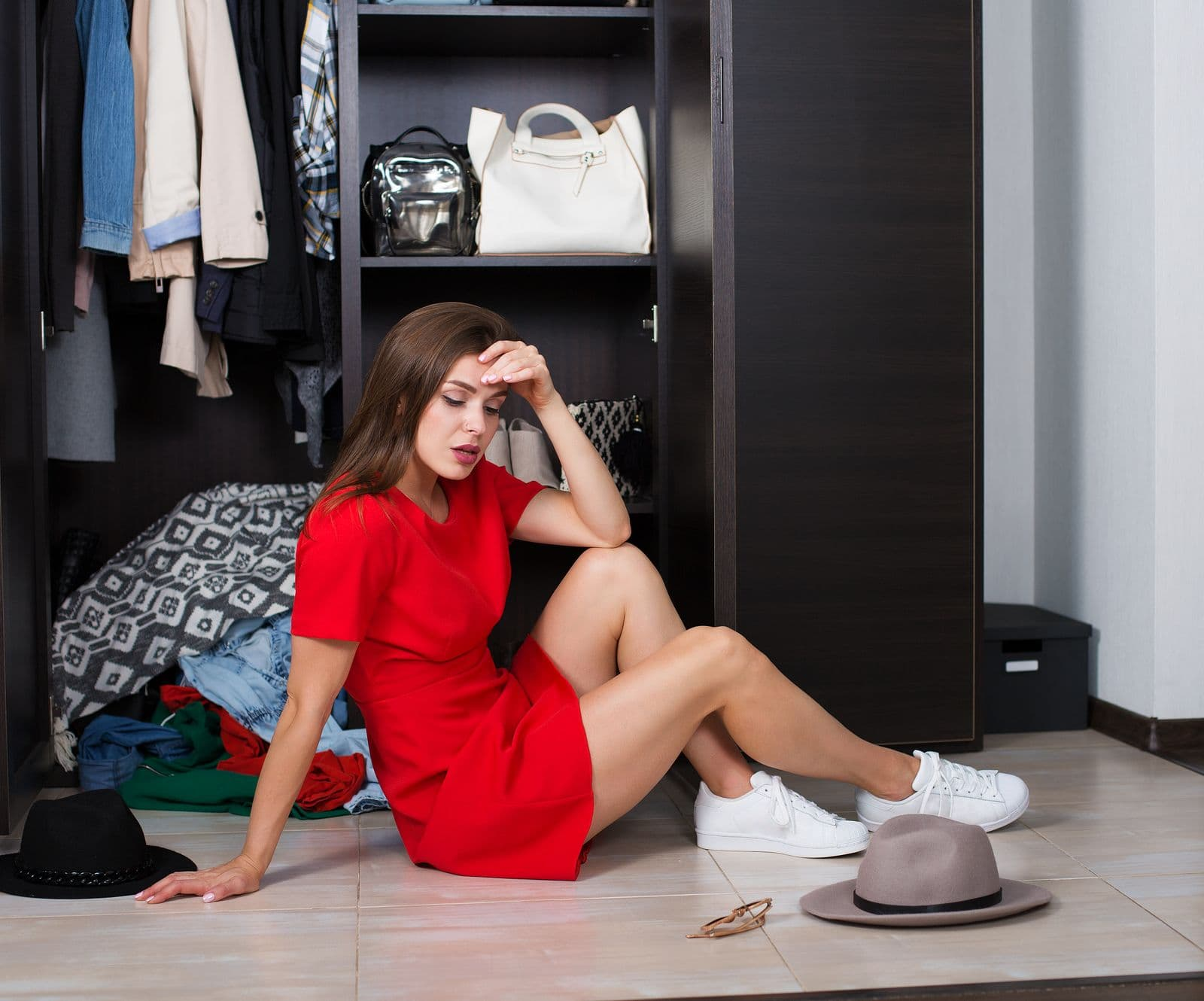 Girl feeling guilty about having too many clothes