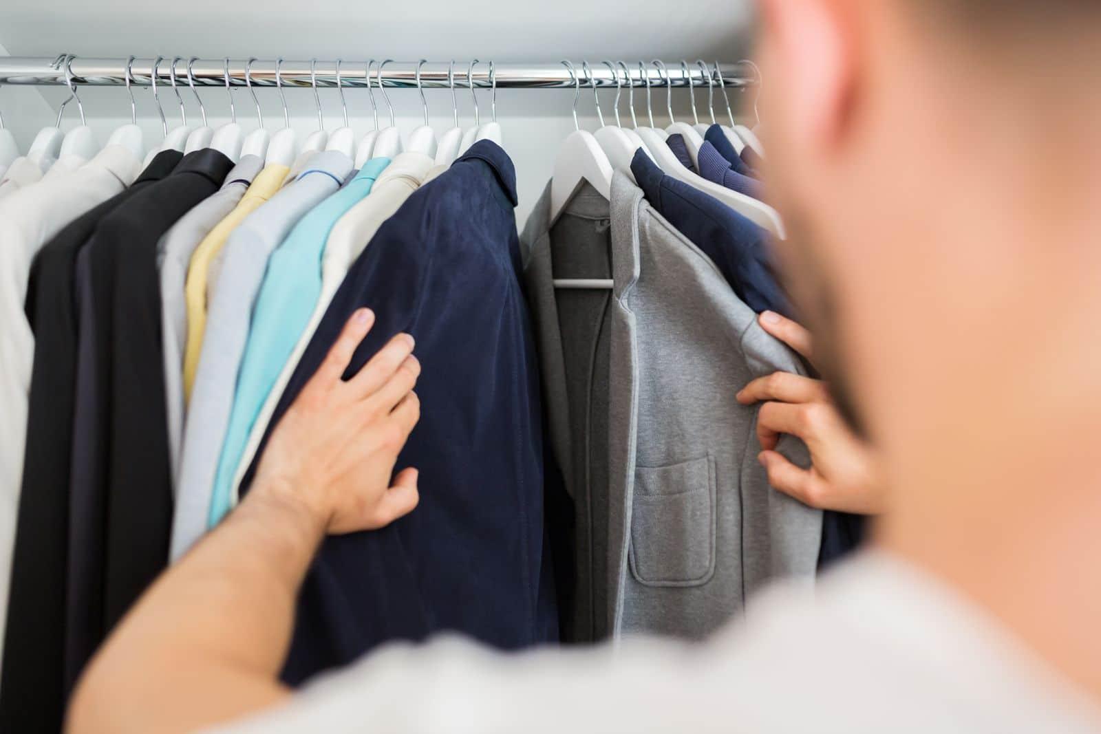 Man looking through his clothes