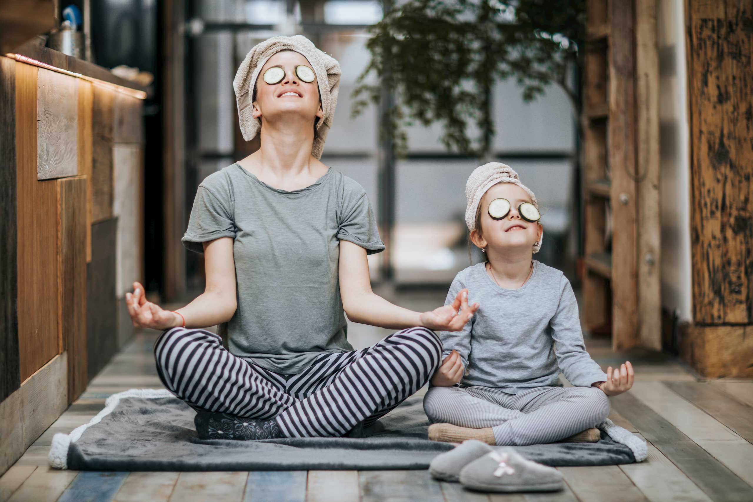 Mother and daughter yoga session