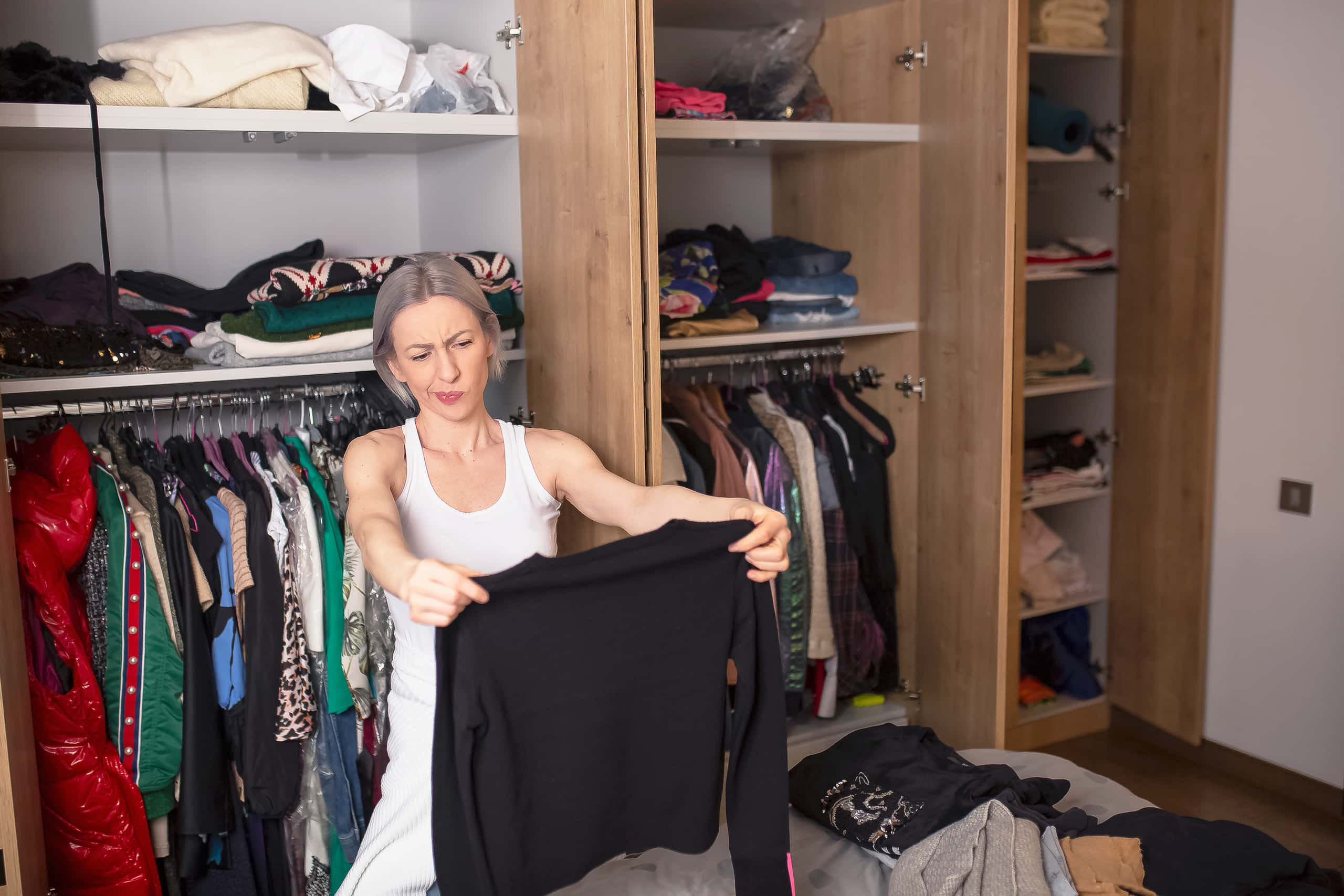 woman cleaning out clothes