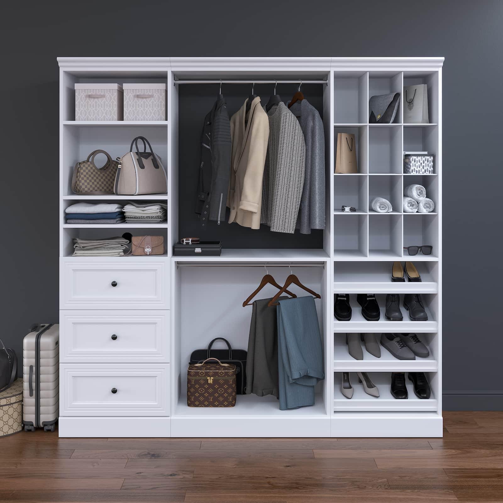 closet organizer in dark room with suitcase