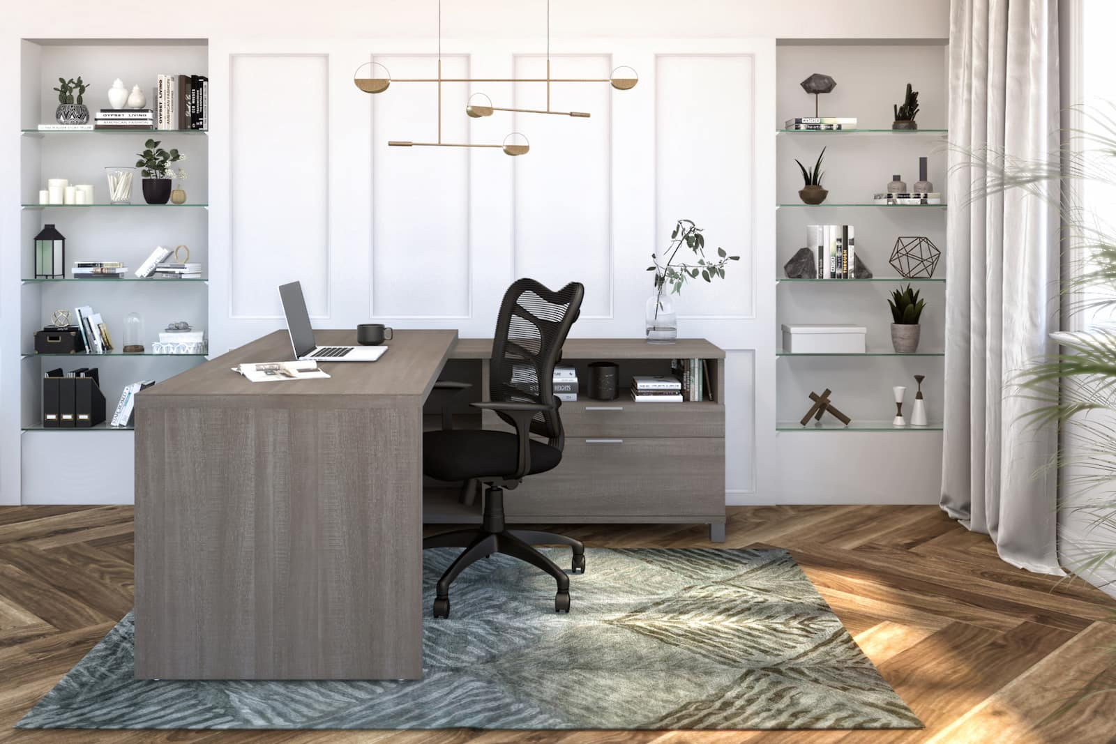 l-shaped desk in big office with large grey rug and fancy light fixture