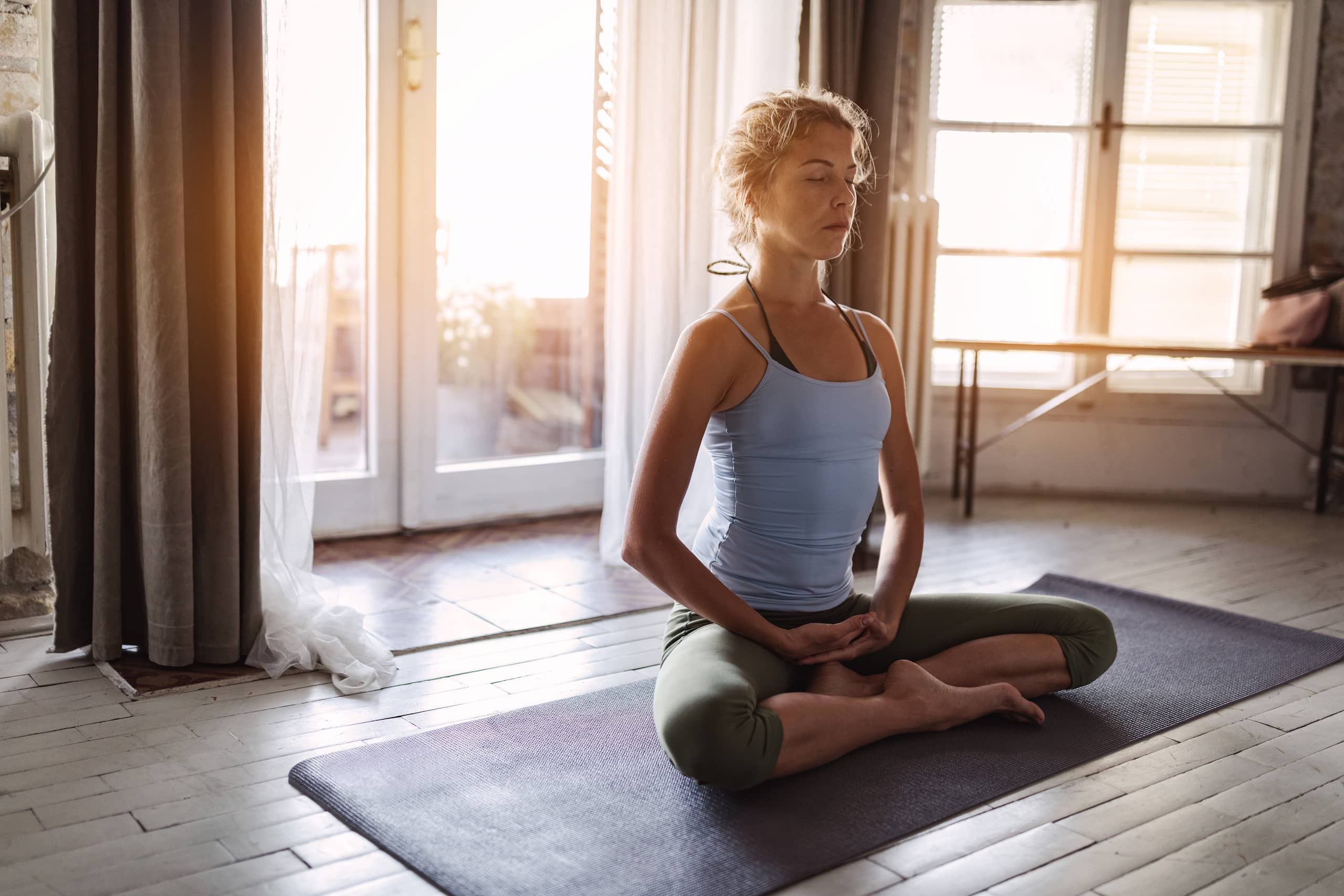 Woman doing yoga in a bright room
