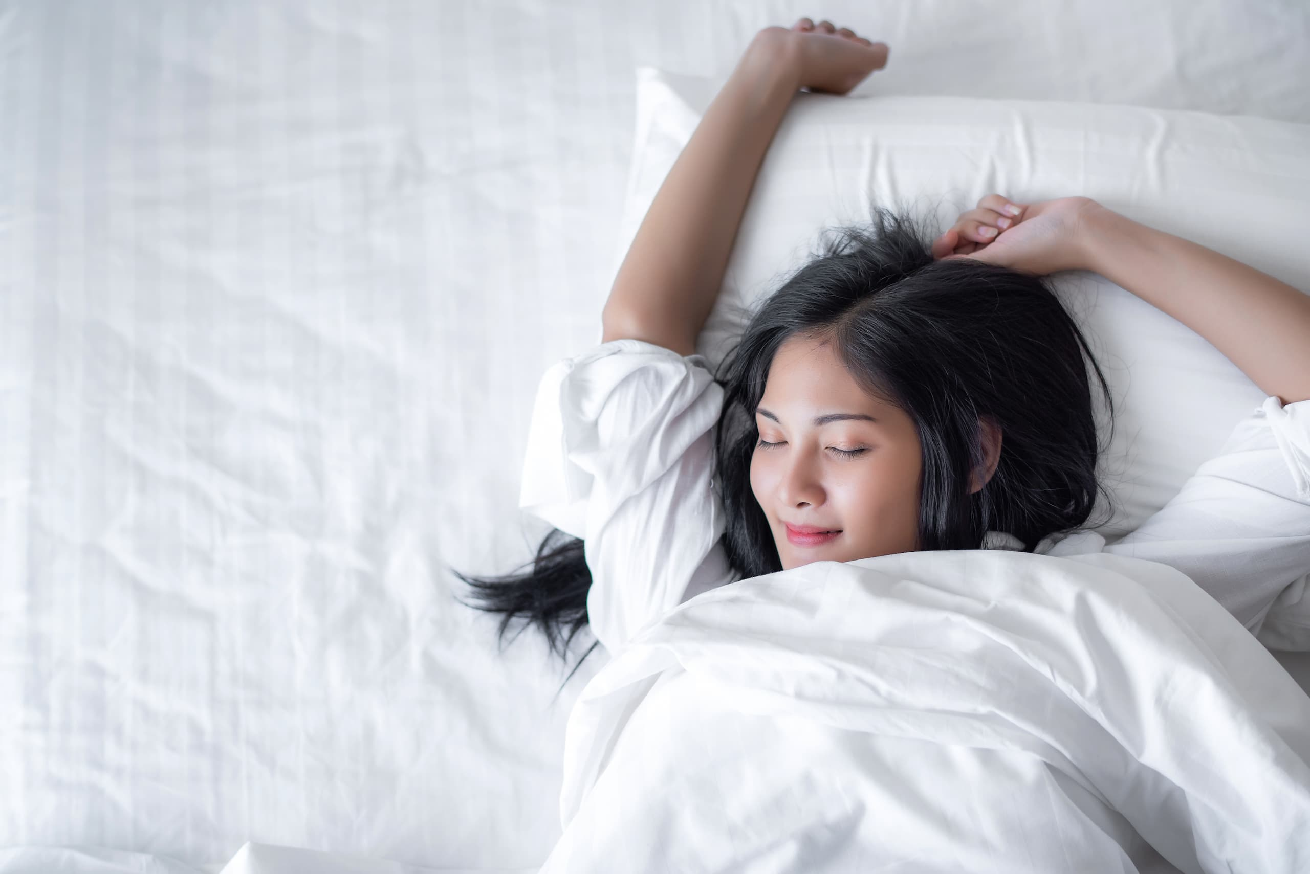 Woman sleeping comfortably in her bed